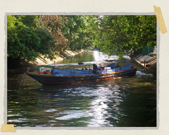 'Our favorite river taxi – the one we took nearly every day while in Bangkok – turning around after dropping us off not far from our hotel