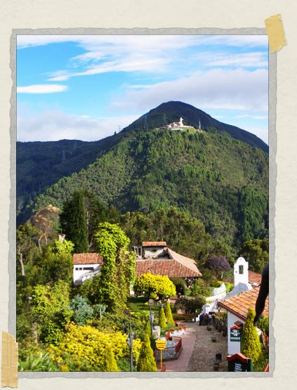 'On top of Monserrate: the city is to the right in this photo (not pictured), while the Fallen Christ (the patch of white showing up against the dark mountain) is in the background