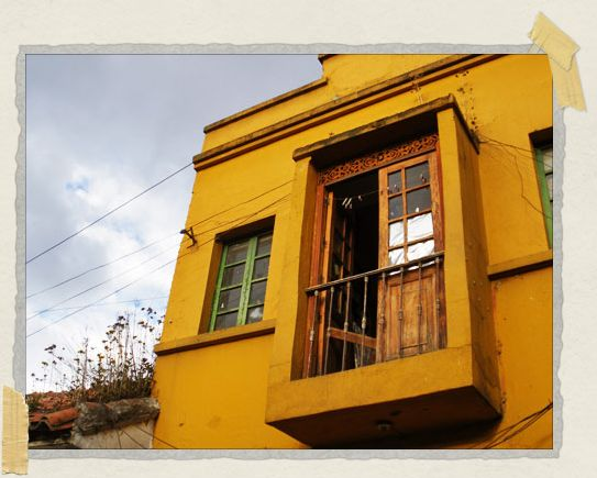 'In the Candeleria neighborhood, many of the colonial buildings were painted in bright yellows, blues, greens, and reds
