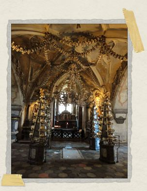 'The center of the ossuary, where a massive bone chandelier hangs from the ceiling