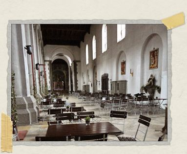 'Just behind where this photo was taken, are the tables where the kegs stand. And yes, you're seeing correctly: this beerhouse is inside the church, to the right of the pews.
