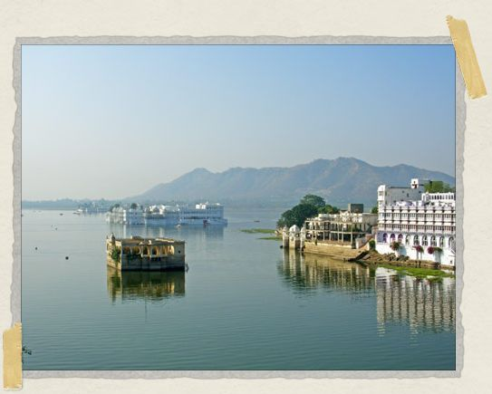 'The view from our balcony: Udaipur's famous Lake Palace Hotel floating in the middle of Lake Pichola