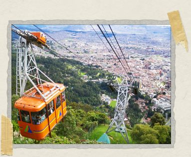 'A teleferico car makes its slow descent back down the mountain with visitors standing safely inside