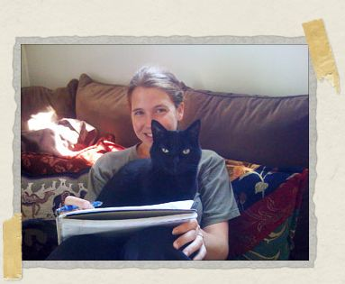 'Our cat China, helping Jessica do a bit of research on South Africa