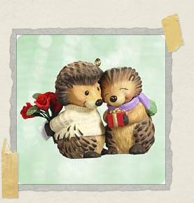 'Our first Christmas ornament together, and the start of our becoming hedgehogs!